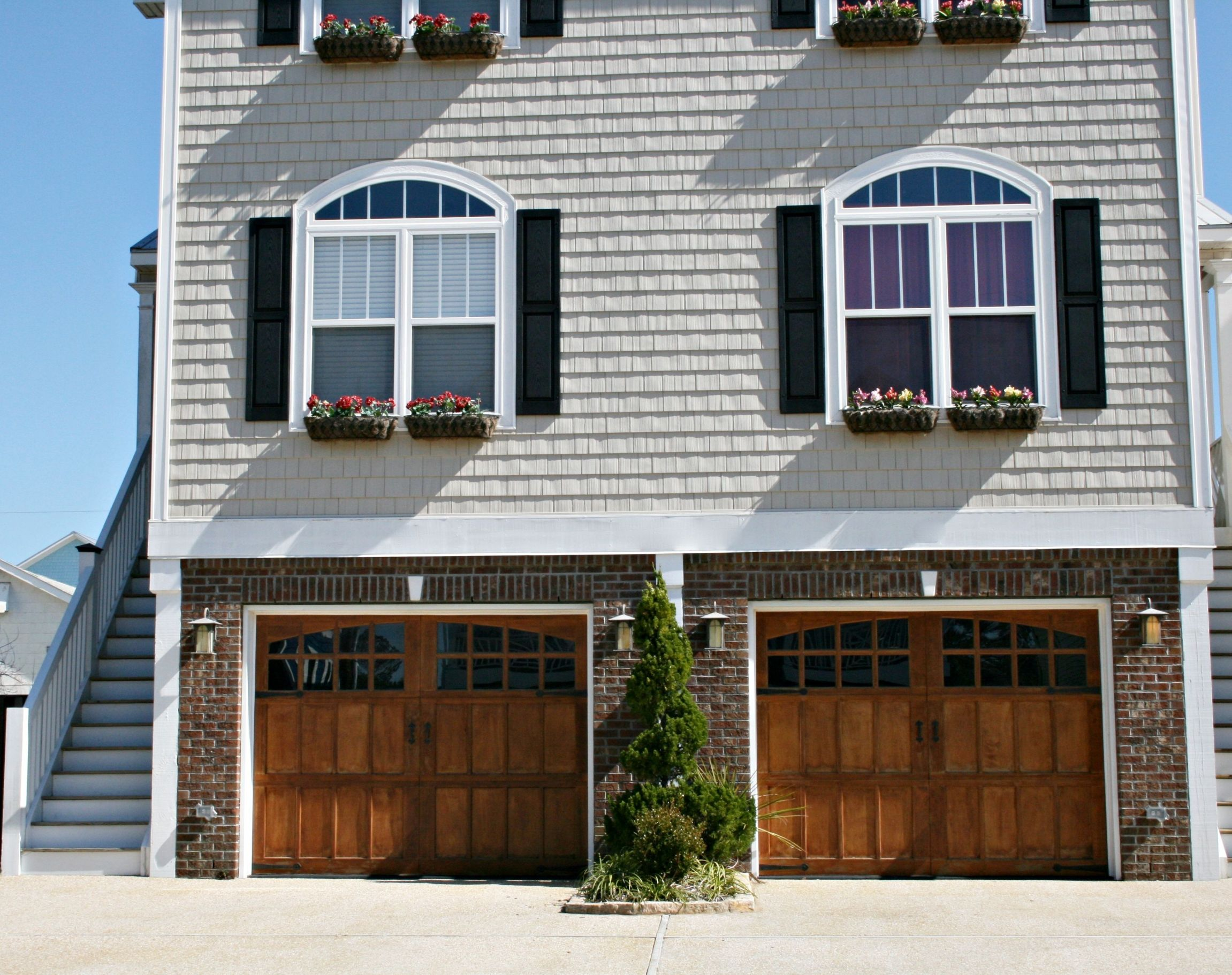 Residential Garage Doors in Iowa City, IA Come in Several Attractive Designs and Materials